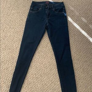 Mid waisted blue jeans/jeggings by Delia's